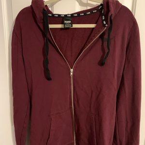 Pink full zip up hoodie.